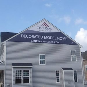 A-Frame Shaped Banner Installed On Home by Sign Central Inc