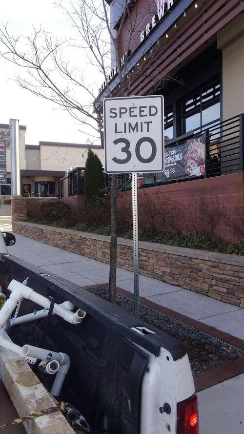Speed Limit Aluminum Sign with post by Sign Central, Inc.